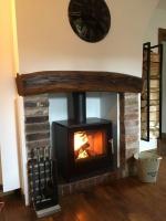 Poêle à bois RAIS Q-tee dans cheminée