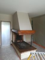 Remplacement d'une cheminée par un poêle à bois de marque RAIS modèle JUNO 166 pierre ollaire